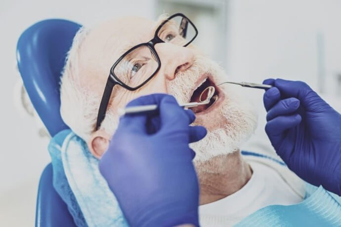 problemas da saúde bucal de um idoso